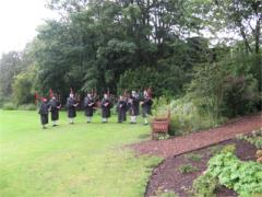 Pipe Band playing in the rain