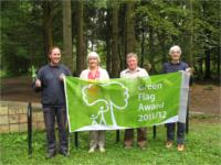 Michael and friends with their new green flag 2011